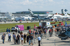 Visitors and guests of the exhibition at the airfield. Royalty Free Stock Photography