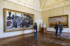 Visitors in the hall of the Russian artist Konstantin Savitsky and Grigory Myasoedovn in the Russian Museum, St. Petersburg Stock Photos