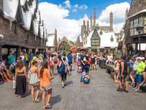 Visitors in the Harry Potter area at Universal Studios Islands o. ORLANDO,USA - AUGUST 24, 2014 : Visitors enjoying the Harry Potter themed attractions and shops Stock Images