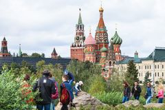Visitors on hill in Zaryadye park and Kremlin Stock Image
