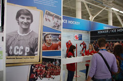 Visitors at ice hockey history exhibition stand Royalty Free Stock Photos