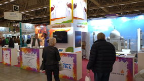 Visitors at the Indian Pavilion at the large international fair of travel agencies. HELSINKI, FINLAND - NOVEMBER 22, 2017: Visitors at the Indian Pavilion at the stock footage