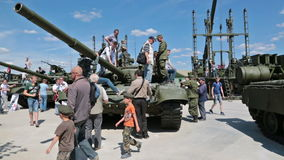 Visitors inspect armored vehicles stock footage
