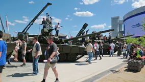 Visitors inspect armored vehicles stock video