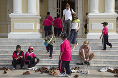 Visitors leave their shoes outside a Thai palace Stock Photography