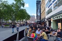Visitors in Leicester Square London UK Royalty Free Stock Images