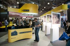 Visitors look at new products on Nikon stand Royalty Free Stock Image
