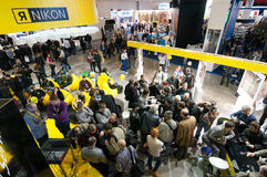 Visitors look at new products on Nikon stand Stock Photography