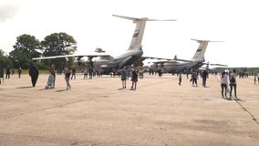 Visitors look at the planes in the open day at the aerodrome Migalovo stock video footage