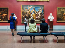 Visitors looking at artworks in Pushkin State Museum of Fine Art Stock Images