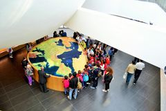 Visitors looking at the Europe map without Italian peninsula at the Italy EXPO Milano 2015 pavilion. Stock Photo