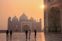 Visitors looking at Taj Mahal at sunrise, Agra, Uttar Pradesh, I. Ndia. Taj Mahal was designated as a UNESCO World Heritage Site in 1983 Stock Images