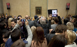Visitors at the Louvre looking at the Mona Lisa royalty free stock photos