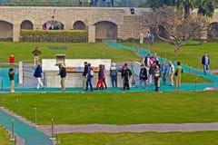 Visitors at Mahatma Gandhi memorial. JANUARY 20, 2015, NEW DELHI, INDIA - European visitors close to Mahatma Gandhi memorial at Rajghat Royalty Free Stock Photo