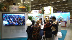 Visitors at the Malaysian pavilion at the large international fair of travel agencies. HELSINKI, FINLAND - NOVEMBER 22, 2017: Visitors at the Malaysian pavilion stock video footage