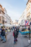 Visitors at market on Rue General Leman in Brussels. Visitors at the local moving market on Rue General Leman in Brussels, Belgium, on 18th February 2018 Royalty Free Stock Photos