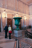 Visitors near the malachite vases. Royalty Free Stock Photo