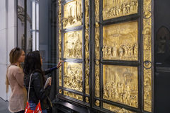Visitors near original gates of Florence Cathedral Royalty Free Stock Photo