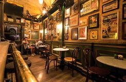 Free Visitors Of Cozy Restaurant In British Retro Style Having Dinner In Vintage Interior Stock Image - 164254091