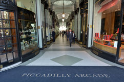 Visitors in Piccadilly Arcade in London UK. LONDON - MAY 14 2015:Piccadilly Arcade in Central London.It�s an historic shopping cente (1819) one of the most Stock Photo
