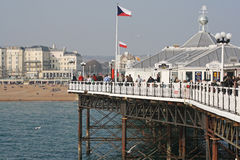Visitors at the pier in Brighton , UK. Visitors at the pier in Brighton.Finished in 1899 and occupied by restaurants,arcades and fair rides the pier is a grade Stock Photo