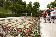 Visitors place flowers at the Kennedys gravesite Royalty Free Stock Image