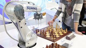 Visitors playing robot chess in game center