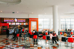 Visitors popular cafe Dunkin Donuts at the modern shopping mall Stock Photography