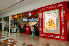 Visitors popular cafe Dunkin Donuts at the modern shopping mall Stock Photo