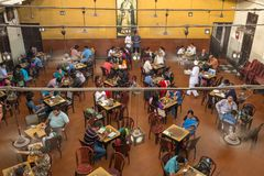 Visitors of popular Indian Coffee House having lunch in Kolkata, India. royalty free stock photography