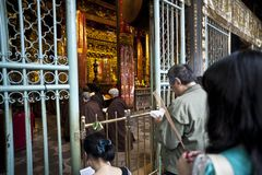 Visitors praying in a Chinese Temple royalty free stock photo