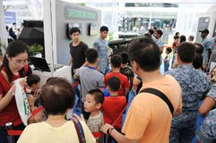 Visitors queuing up to interact with a simulated man-portable air-defense missile system stock image