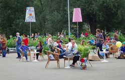Visitors resting in chairs in the park Royalty Free Stock Photo