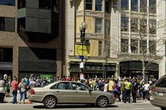 Visitors return to Marathon Place. Boston, Massachusetts USA - April 28, 2013 - Crowds gather at Marathon Place, site of one of two Marathon bombings. The Royalty Free Stock Photography