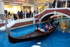 Visitors ride on gondola boat in Venetian Hotel in Macau Stock Images