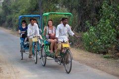Visitors riding cycle rickshaw in Keoladeo Ghana National Park i Stock Photos