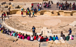 Visitors at the Roman Theatre in Cartagena. School children, students and their guides on an educational visit to the Roman Theatre in Cartagena,  Spain Royalty Free Stock Photos