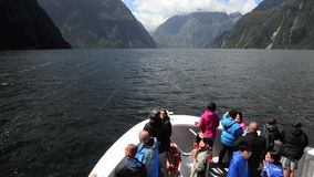 Visitors sail in Milford Sound NZ. MILFORD SOUND,NZ - JAN 14:Visitors sail in Milford Sound on Jan 14 2014.It has been judged the world's top travel destination stock footage