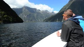Visitors sail in Milford Sound NZ stock video footage