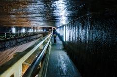 Visitors in the salt mine Turda, Cluj, Romania. Visitors walking in the tunnel of the salt mine Turd, Cluj, Romania Stock Photos