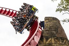 Roller Coaster Amusement Ride Plunge. Visitors scream during a downward plunge on a theme park roller coaster in Florida Royalty Free Stock Images