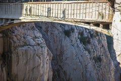 Visitors shadows crossing the suspension bridge at Gaitanes Gorg Royalty Free Stock Image
