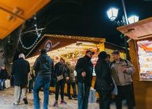 Visitors shopping happy admiring  Christmas Market Stock Photo