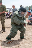 Visitors of show try on the sapper suit Royalty Free Stock Photo