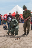 Visitors of show try on the sapper suit Royalty Free Stock Images