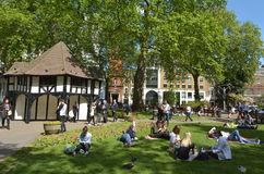 Visitors at Soho Square on Sunny day in London Stock Photo