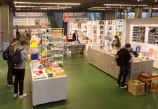 Visitors of souvenir shop inside the Danish Architecture Center buying books and design things. COPENHAGEN, DENMARK - SEPT 5: Visitors of souvenir shop inside royalty free stock photos