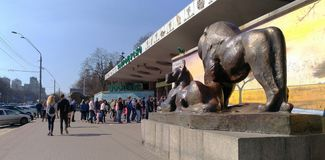Visitors stand in line at the entrance to the Kiev zoo at spring time. KIEV - UKRAINE - APRIL 2017: Visitors stand in line at the entrance to the Kiev zoo. Warm royalty free stock photography
