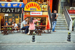 Visitors of street cafe sitting outdoor in Istanbul Stock Photo