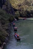 Visitors take a bamboo raft drifting in Mountain Wuyi  Royalty Free Stock Images